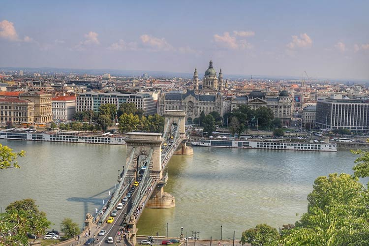 The Széchenyi Chain Bridge is a suspension bridge that connects Buda and Pest across the Danube River.