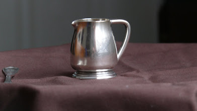 Photo: Silver service creamer with PA logo