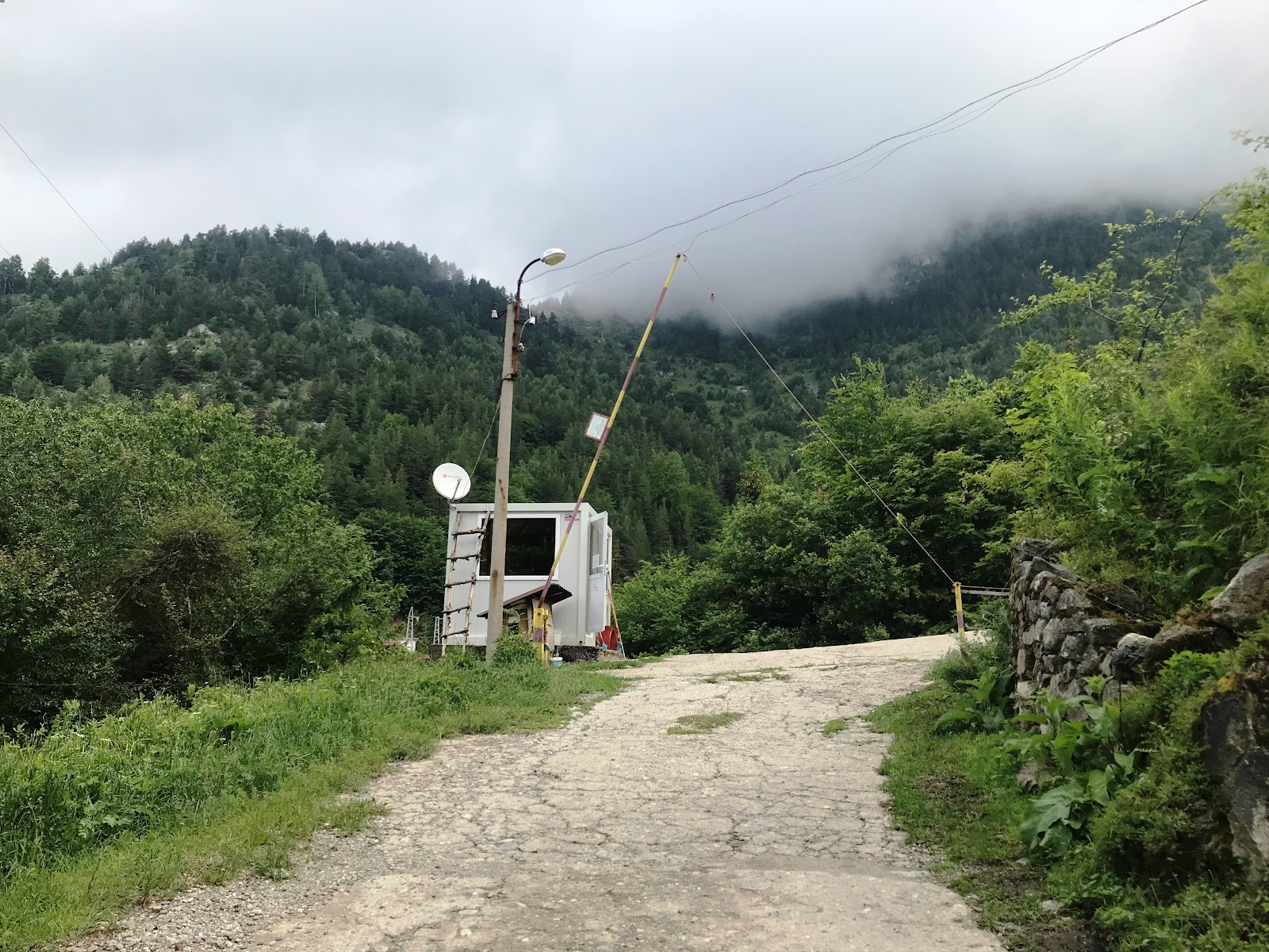 Guard shack and gate on bicycle climb up Rila