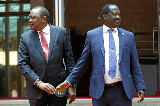 Kenyan President Uhuru Kenyatta, left, greets opposition leader Raila Odinga after addressing a news conference at the Harambee house office in Nairobi, on March 9 2018. Picture: REUTERS