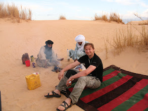 Photo: Sore and bruised but not beaten, enjoying mint tea as we prepare to camp in the dunes