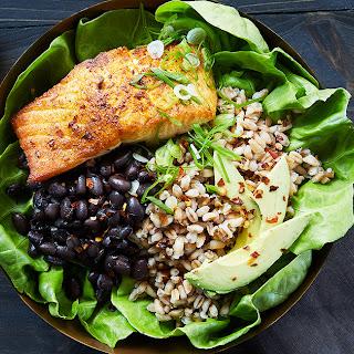 Salmon Bowl with Farro, Black Beans and Tahini Dressing.