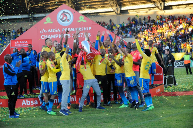 Mamelodi Sundowns coaching and playing stuff lift the Absa Premiership 2018/19 trophy after a goalless draw away at Bloemfontein Celtic on Saturday May 12 2018.