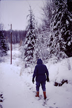 Photo: Lorraine walking down the snow covered road.