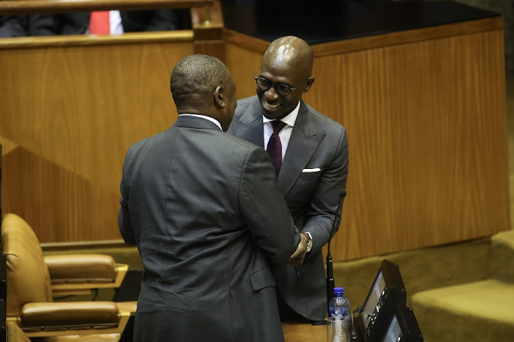 Finance Minister Malusi Gigaba congratulated by President Cyril Ramaphosa following his 2018 Budget speech in Parliament, Cape Town.