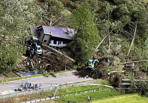 Police officers and rescue workers search for survivors from a building damaged by a landslide caused by a powerful earthquake, in Atsuma town on Japan's northern island of Hokkaido, on September 6 2018. Picture: KYODO VIA REUTERS