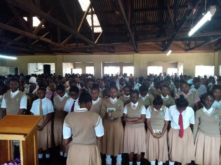 Kerugoya Girls High School students during a past parade session. Now they will need masks and must practice social distancing..