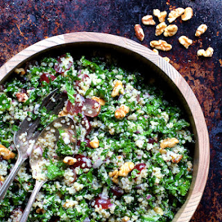 Quinoa and Kale Salad with Red Grapes, Walnuts and Honey – Lemon Dressing.