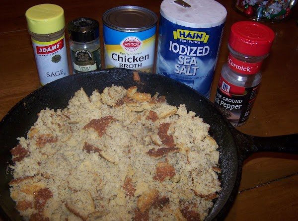 Break cooled cornbread into bowl. Add seasonings. Mix together lightly. Pour one can chicken...