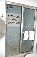 Photo: Master bath - large tiled shower in beach motive with hand-painted frieze