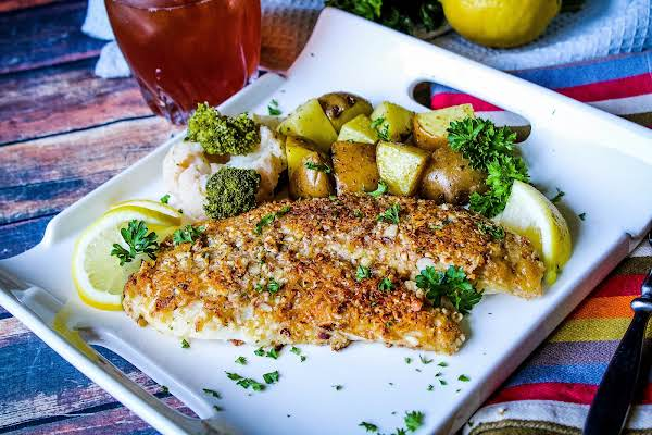 Almond Crusted Tilapia With Lemon Wedges.