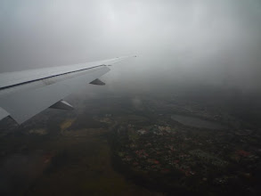 Photo: Misty Johannesburg from the plane / Zatazeny Johannesburg z letadla