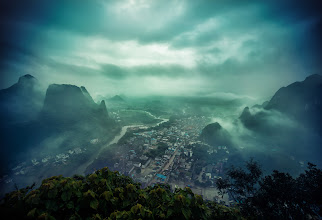 Photo: I just climbed one of those ridiculous mountains you saw from the previous photo and I can see a beautiful little town below, under the curving mists that come off the Lijiang river...