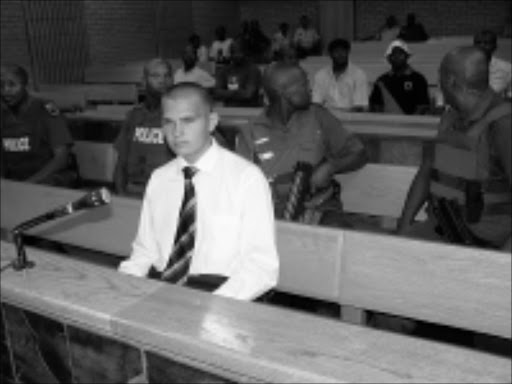 in the dock: Murder accused Johan Nel during his court appearance yesterday. He is facing multiple murder charges. 17/11/2008. © Sowetan. Pic. Elisha Molefe.