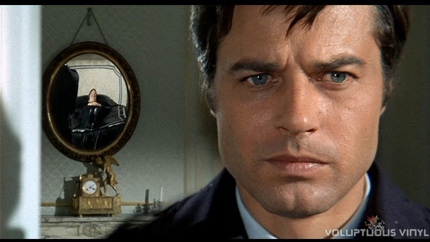 Jean Sorel his dead wife (Marisa Mell) shown lying in repose in the mirror.