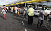 ​Long queues form outside Makro in Otterey, Cape Town, on March 25 2020, as people shop before SA goes into lockdown.