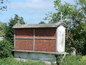 Photo: Grenier à grains ,un côté celte et un coté chrétien dans le haut
