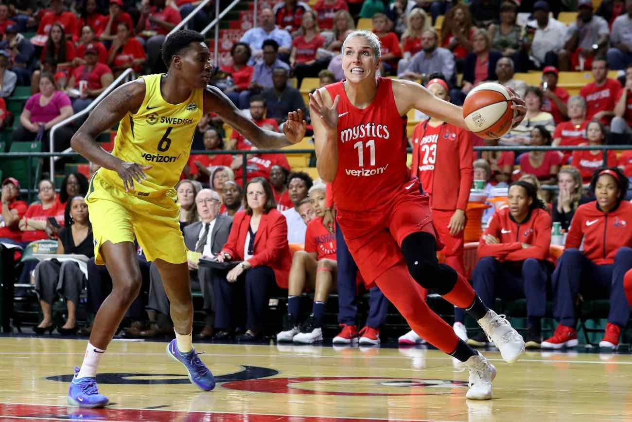 FAIRFAX, VA - SEPTEMBER 12: Elena Delle Donne #11 of the Washington Mystics drives to the basket against Natasha Howard #6 of the Seattle Storm in the second half during game three of the WNBA Finals at EagleBank Arena on September 12, 2018 in Fairfax, Virginia. (Photo by Rob Carr/Getty Images)