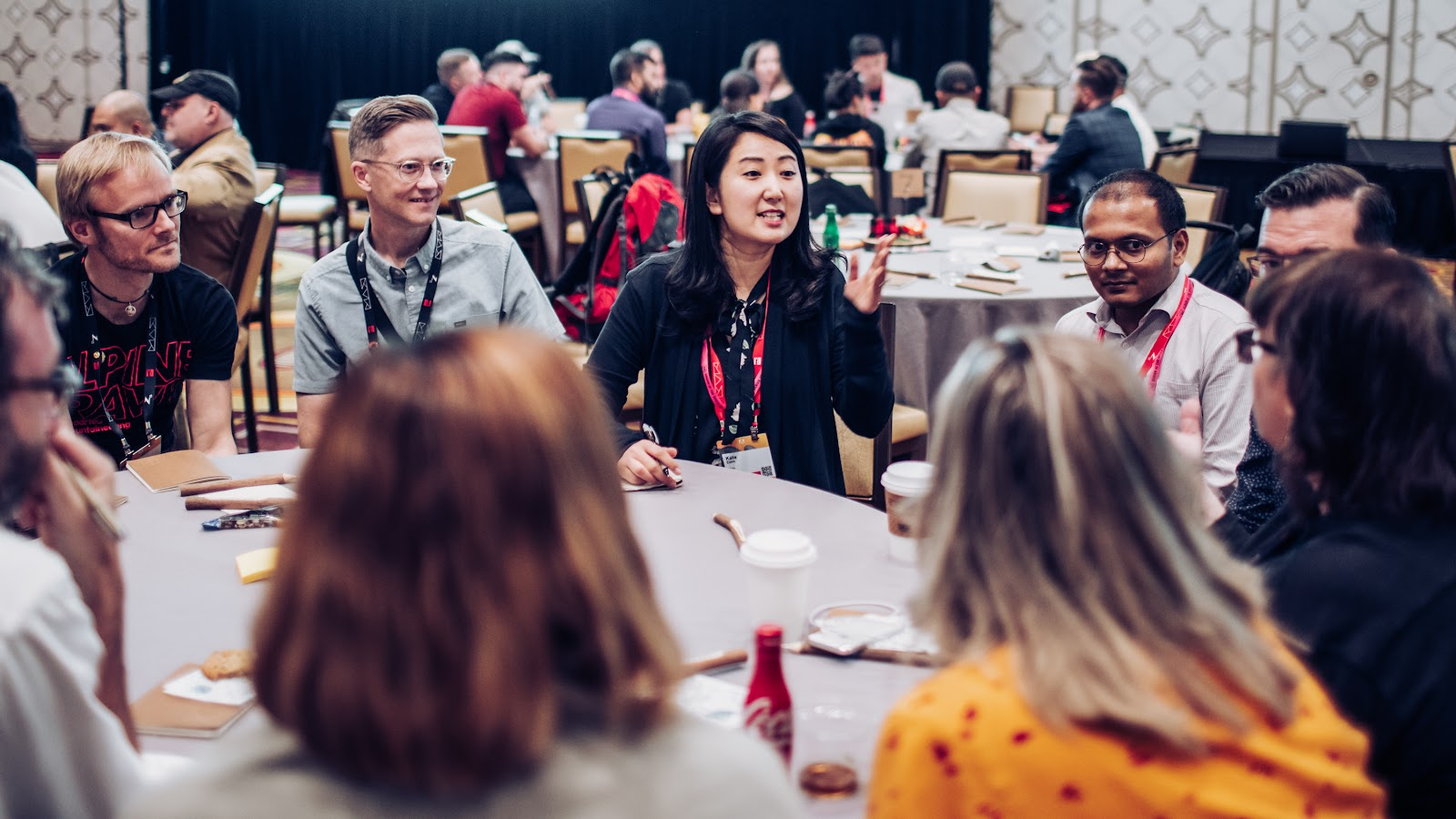 Adobe Max 2019 attendees participate in a round-table discussion at XD Summit.