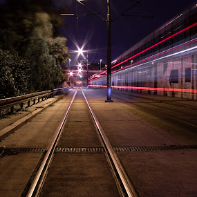 Warp by Nenad Borojevic Foto - City,  Street & Park  Night ( rails, wood, radside, street, cable, forest, road, poles, outline, city, grafitti, lights, trams, sky, pole, tree, cables, night, bumper, passing,  )