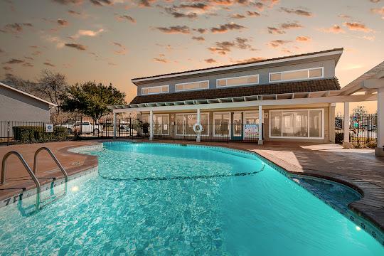 Villas at The Parks apartment swimming pool at dusk
