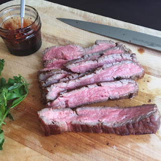 Lemony Seared Flank Steak with Pomegranate Molasses.