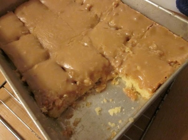 FOR THE PEANUT BUTTER ICING: Bring to a boil 1 stick of butter, 1/2 cup...
