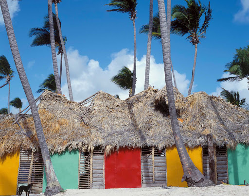 Cuba-Colorful-Huts-with-Palm-Tree-Trunks.jpg - Colorful huts on a Cuban beach.