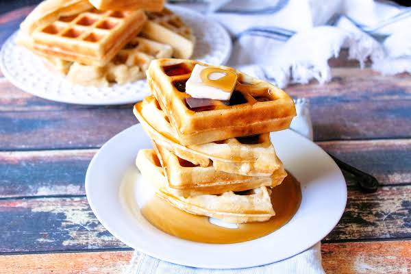 Syrup And Butter Over Big Fluffy Waffles.