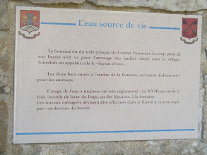 "Photo: Another historical plaque by the fountain: water, the source of life. The fountain is in a typical style for the Comtat Venaissin. Most of its contents goes for watering the gardens below the village. Formerly, that was called the ""fleeing water."" The two tanks situated at the rear served as a watering place for animals. Water use was always highly regulated: in the 17th century, washing of linen or vegetables in the fountain was forbidden. Such housework could be done in the flow at ""six or seven paces"" below the basin."
