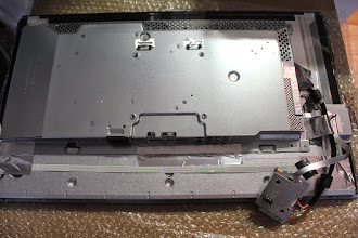 Photo: Back panel completely removed, USB port separated.