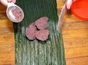 Photo: measuring good-quality shrimp paste onto a piece of banana leaf for the southern-style shrimp paste rice