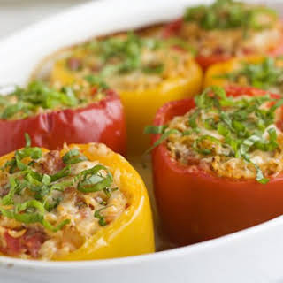 Bell Peppers Stuffed With Rice And Fried Onion.