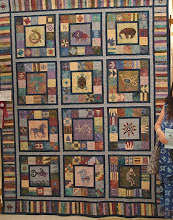 "Photo: This is Mary's prize winning quilt entitled ""Echoes of the Past.""It took first place in the Interna   tional Plowing Match in Ontario in 2007 in the category of Applique Quilt with Long arm quilting. It is a southwestern pattern by Elizabeth Anne Quilt esigns with a few colour and blocs changes to suit Mary's decor. More sashings and border were added to enlarge quilt to King size."