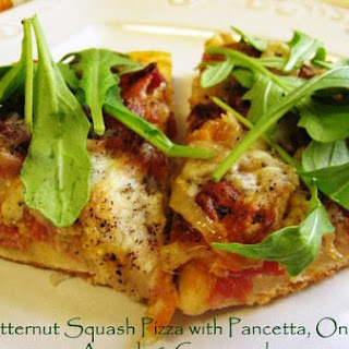 Pizza with Pancetta, Caramelized Onions, Gorgonzola and Arugula.