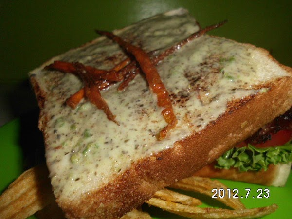 Spread mayo on toasted bread, top with lettuce, tomato, onion, bacon and fried carrot...