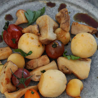 Bergkase Dumplings with Porcini Mushrooms, Apples, and Pumpkinseed Oil.