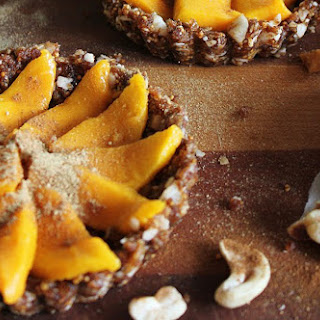 Raw Coconut Mango Tarts with Figs, Walnuts, Cinnamon, and Ginger.