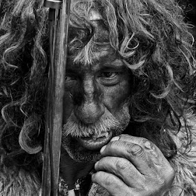 A beggar by Elias Spiliotis - People Portraits of Men ( beggar, black & white, eating, old man, senior citizen, portrait, man, face, people,  )