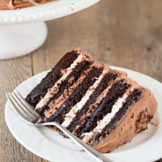 Six-Layer Chocolate Cake with Toasted Marshmallow Filling & Malted Chocolate Frosting.
