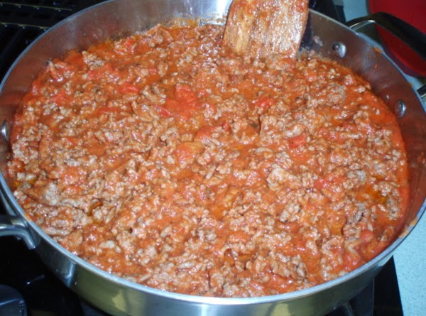 Preheat oven to 375 degrees. In a large frying pan, brown ground beef with...