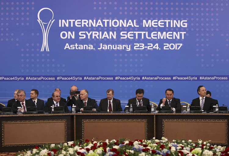 Participants of Syria peace talks attend a meeting in Astana, Kazakhstan, on Monday. Picture: REUTERS