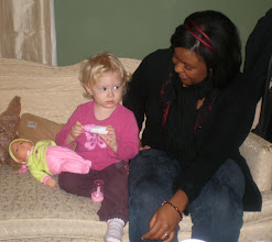 Photo: Kelli helps her tend to the baby
