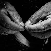 Mani pescatore di