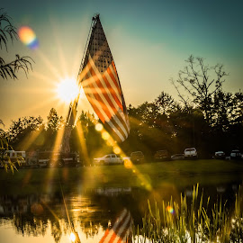sun shins bright on Old Glory by Joe Permenter - Public Holidays July 4th ( water, holiday, reflection, flag, sunset, firetruck, 4th of july, sun )
