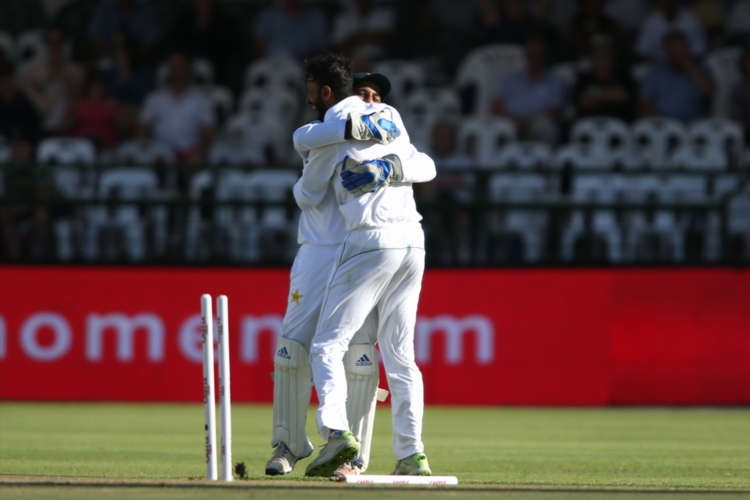 Shan Masood of Pakistan is congratulated by Pakistan captain Sarfraz Ahmed for bowling Aiden Markram of South Africa during day 1 of the 2nd Castle Lager Test match between South Africa and Pakistan at PPC Newlands on January 3 2019 in Cape Town, South Africa