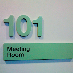 green signage that says 101 meeting room