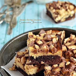Peanut Butter Snickers Cheesecake Brownies.