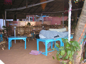 Photo: Restaurant table by day bed by night Varkala Cliff Top