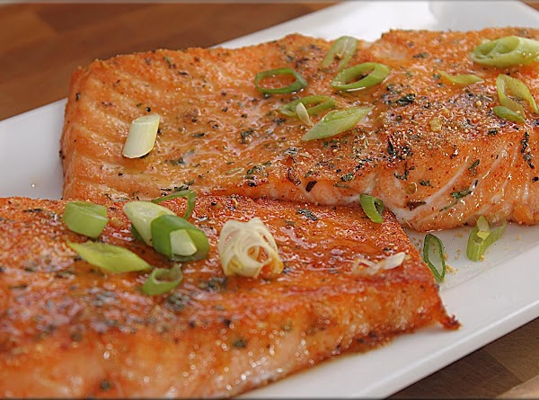 Remove from oven and garnish with fresh scallions and serve with lemon slices.